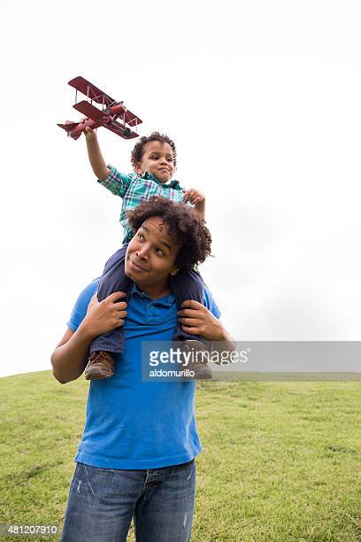 Father and son playing with airplanes