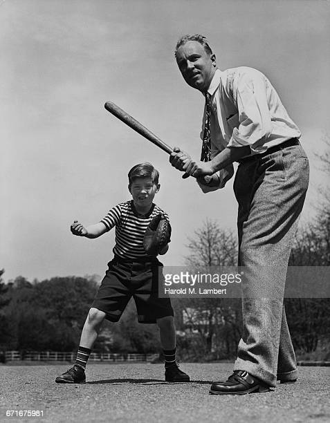 father and son playing with baseball - {{ contactusnotification.cta }} stock pictures, royalty-free photos & images