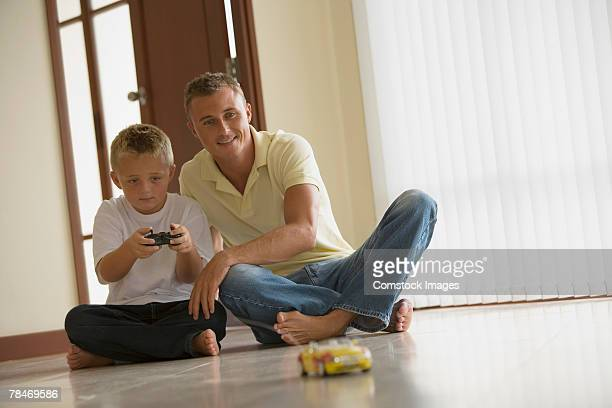 father and son playing with rc toy car - rc car stock photos and pictures