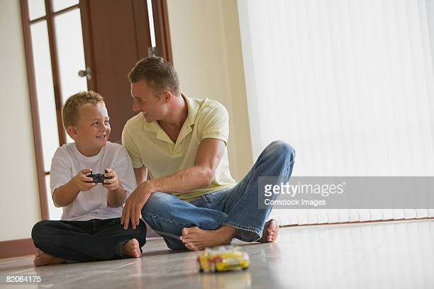 Father and son playing with toy car