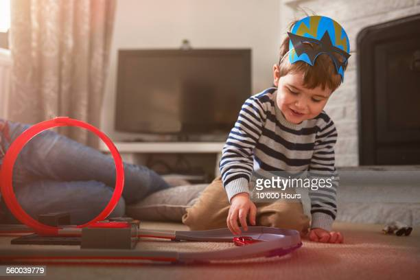 A father and son playing with toy cars