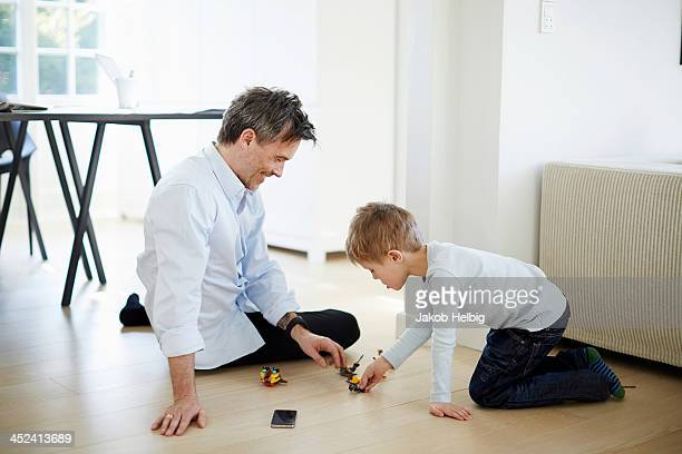 Father and son playing with toys