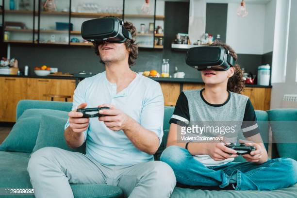 father and son playing with vr - cyberspace stock pictures, royalty-free photos & images