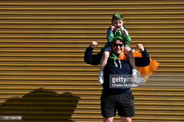 Father and son pose for a picture on St. Patrick's Day in Dublin city centre on March 17, 2021 in Dublin, Ireland. St. Patrick's Day has again been...