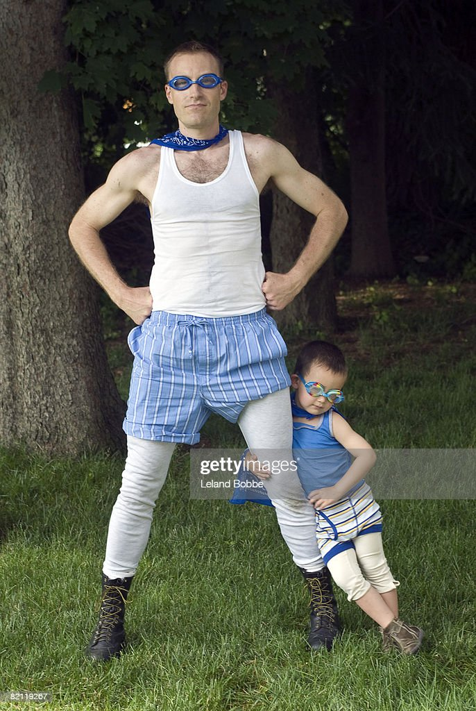 father and son posing as super heroes : Stock Photo