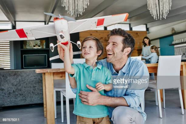 Father and son pplaying with toy airplane