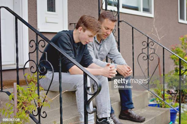 father and son pray - the god father stock photos and pictures