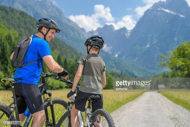 father and son preparing for cycling - fingerless gloves stock pictures, royalty-free photos & images