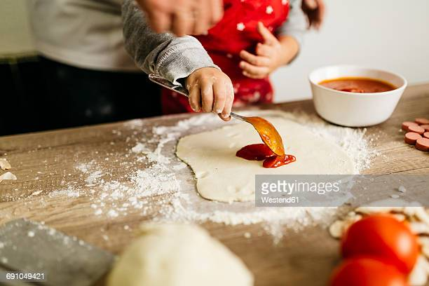 father and son preparing pizza together - home made stock pictures, royalty-free photos & images