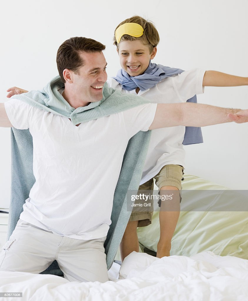 Father and Son Pretending to be Super Heroes  : Stock Photo