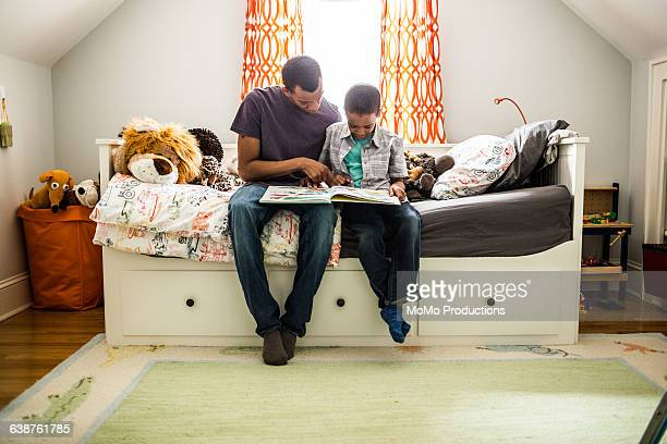 father and son reading - homeschool stock pictures, royalty-free photos & images