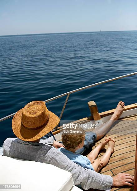 Father and son relaxing on boat