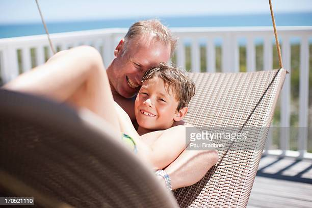 Father and son relaxing on deck