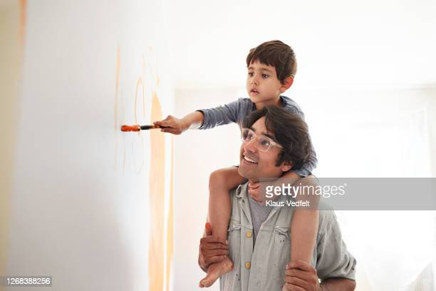 father and son renovating home - one parent stock pictures, royalty-free photos & images