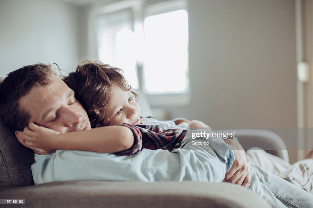 Father and son resting together : Stock Photo