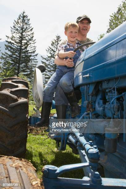 Father and Son Riding Tractor