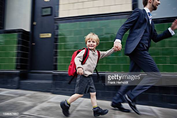 Father and son running to school