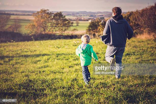 Father and son running together outdoors