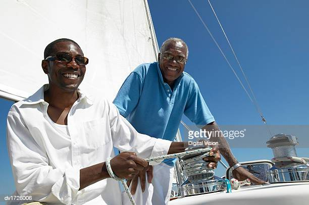 Father and Son Sailing on a Yacht