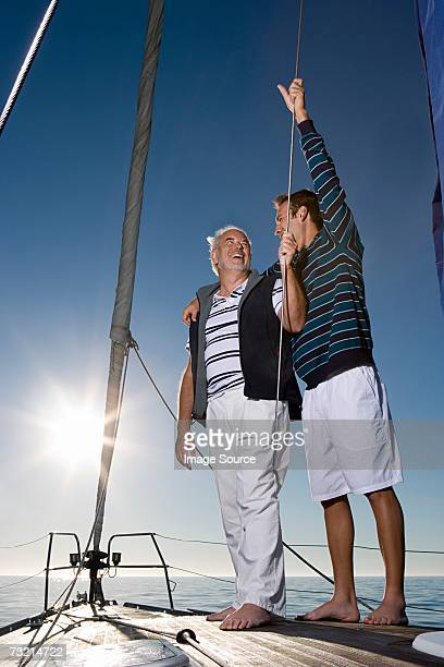 Father and son sailing