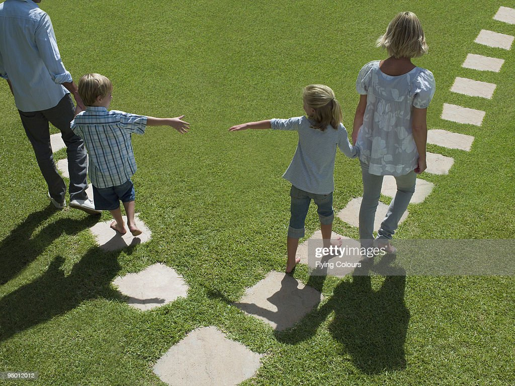 Father and son separating from mother and daughter : Stock Photo