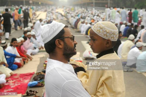 Father and son share bonding during Eid al-Adha, at Indira Gandhi Sarani on August 12, 2019 in Kolkata, India. The holy festival of sacrifice, which...