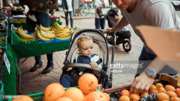 father and son shopping together - baby stroller stock pictures, royalty-free photos & images