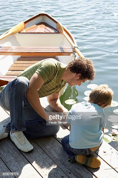 father and son side by side - boys bum stock photos and pictures