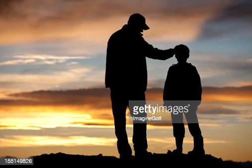 father and son silhouette stock photo getty images