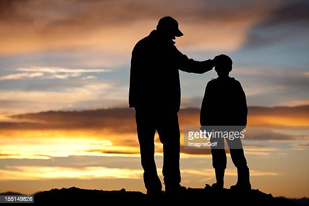 father and son silhouette - fathers day stock pictures, royalty-free photos & images