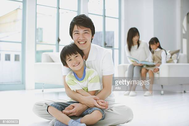 father and son sitting down - 16:9 ストックフォトと画像