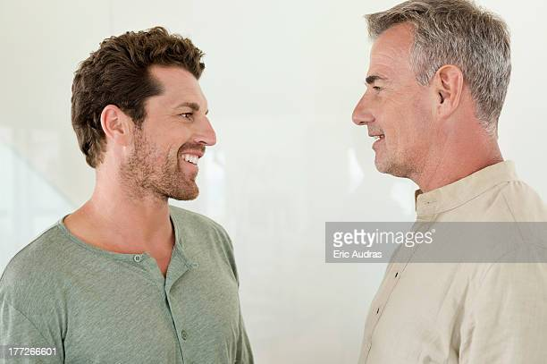 Father and son smiling at each other