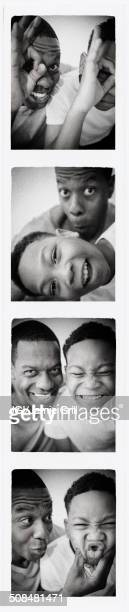 Father and son smiling in photo booth picture