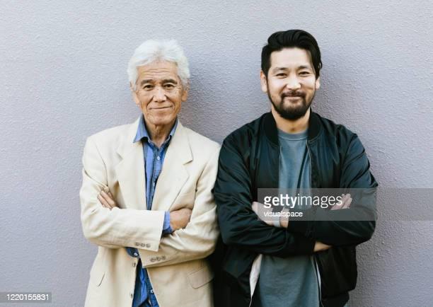 父と息子の笑顔 - 60代 ストックフォトと画像