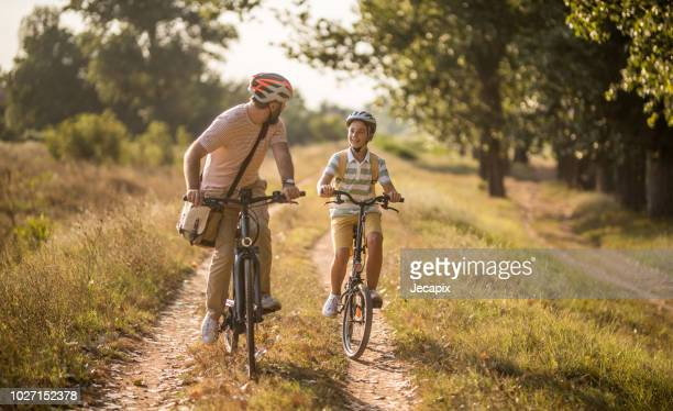 father and son spending time together - cycling helmet stock photos and pictures