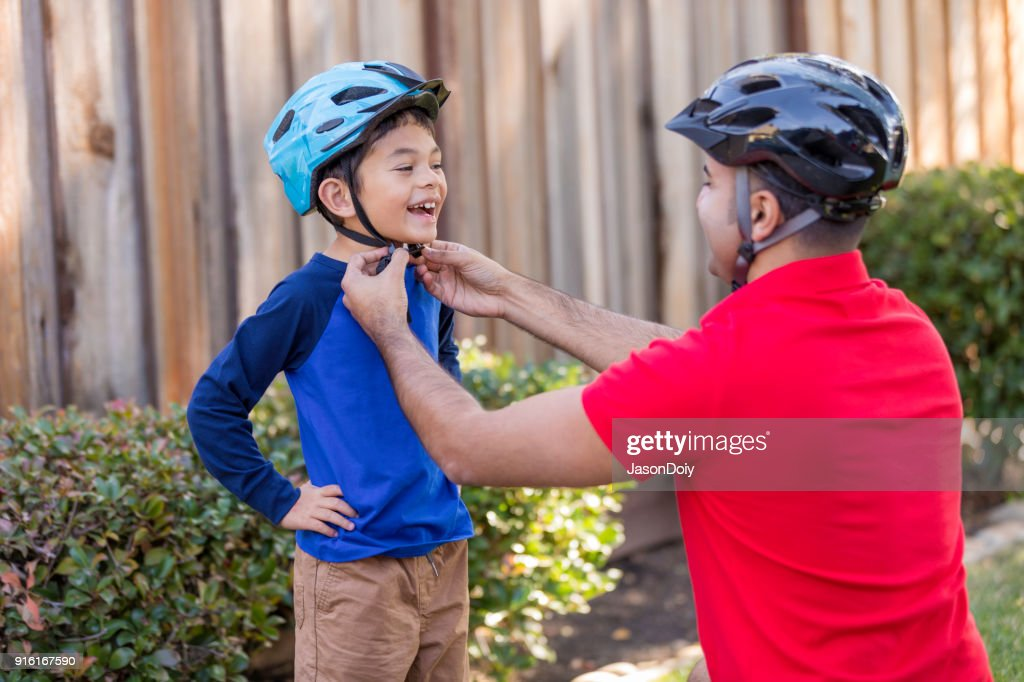 Father and Son Sports Safety : Stock Photo