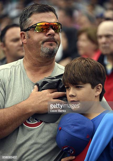 A father and son stand for the national anthem before the game between the Chicago Cubs and the Arizona Diamondbacks on June 4 2016 at Wrigley Field...