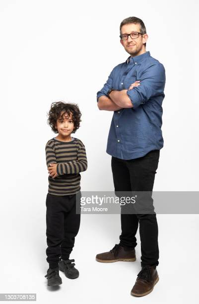 father and son standing - plain background stock pictures, royalty-free photos & images
