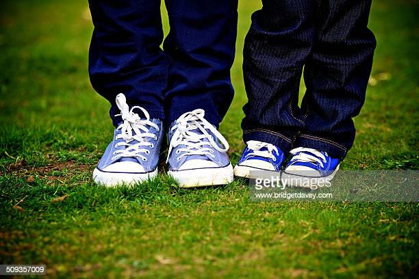 Father and Son standing up, Feet only