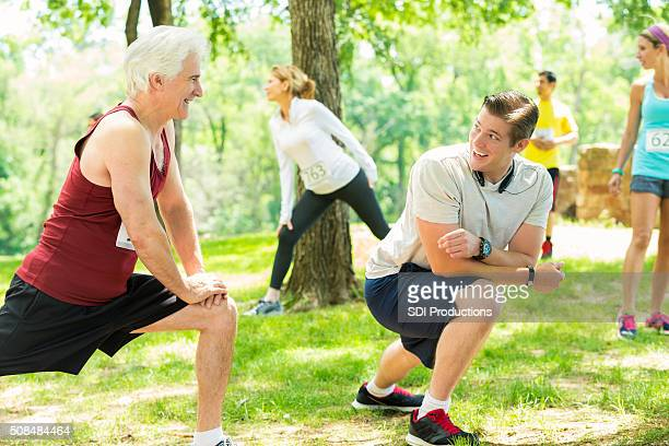 Father and son stretch before 5k race