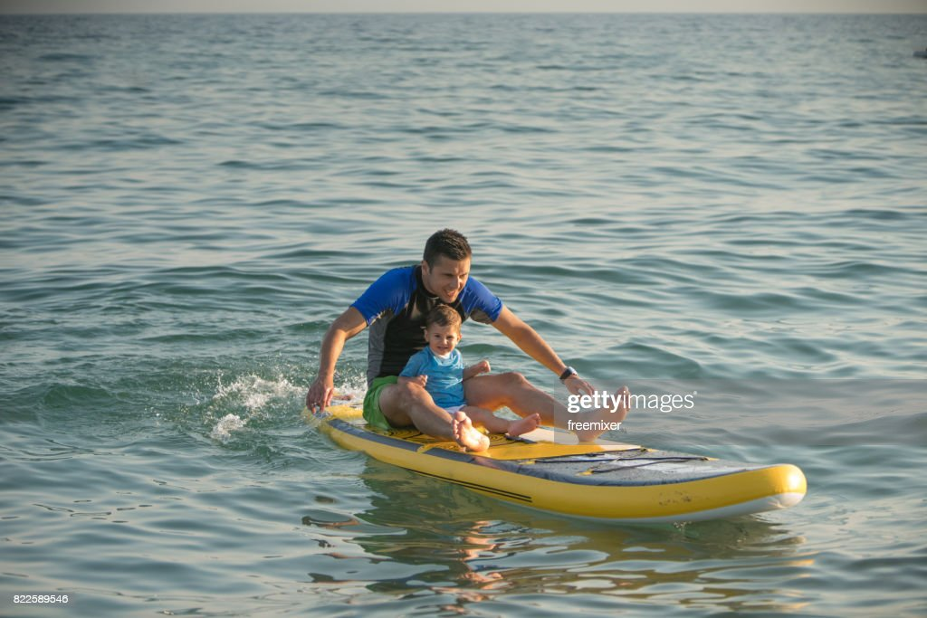 Father and son surfing : Stock Photo