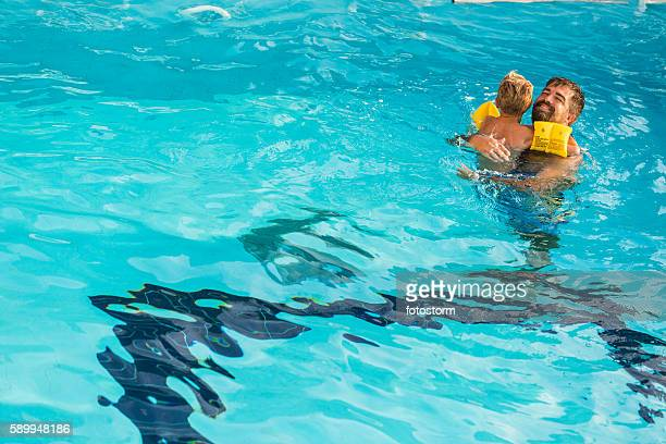 Father and son swimming together