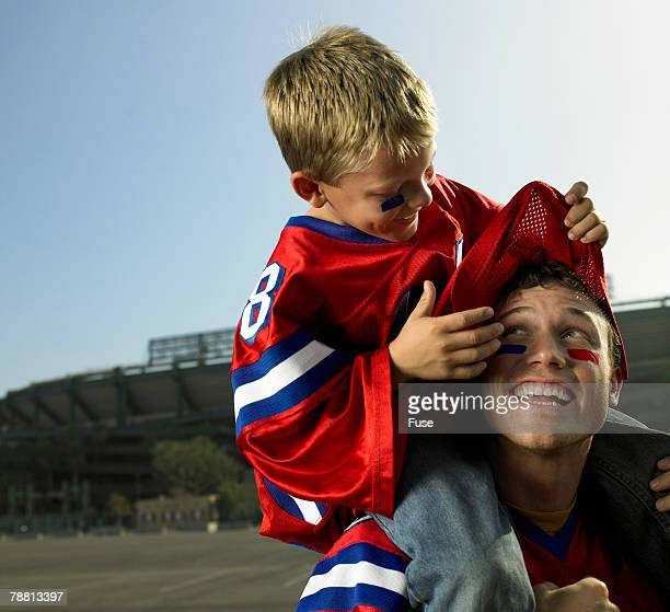 father and son tailgating - foam finger stock photos and pictures