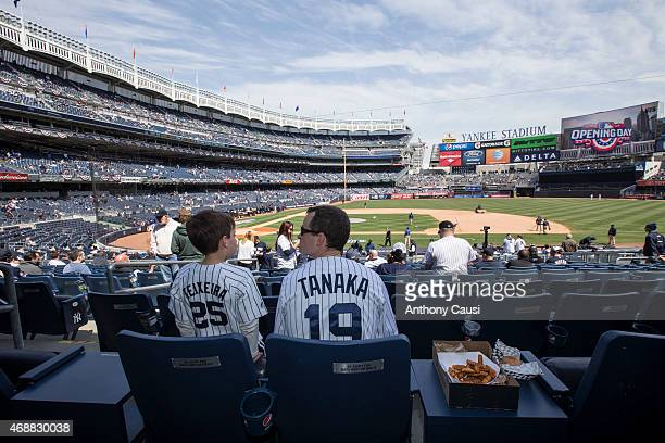A father and son take their seats before the Opening Day game between the Toronto Blue Jays and the New York Yankees at Yankee Stadium on Monday...