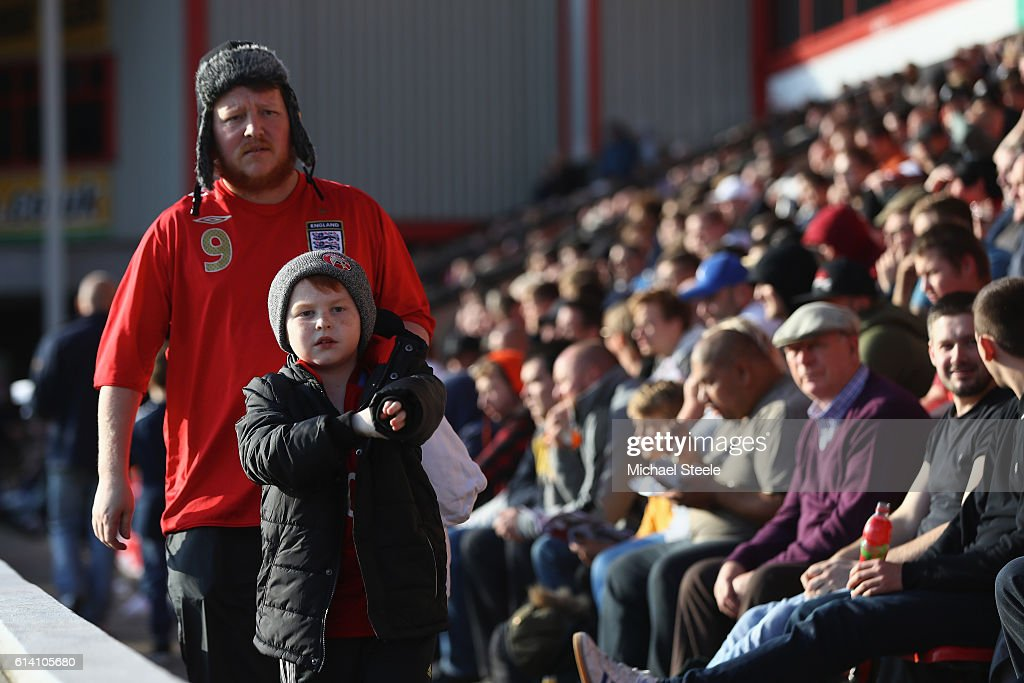 Father and son take their seats during the UEFA European U21 Championship Group 9 match between England and Bosnia Herzegovina at Banks' Stadium on October 11, 2016 in Walsall, England.