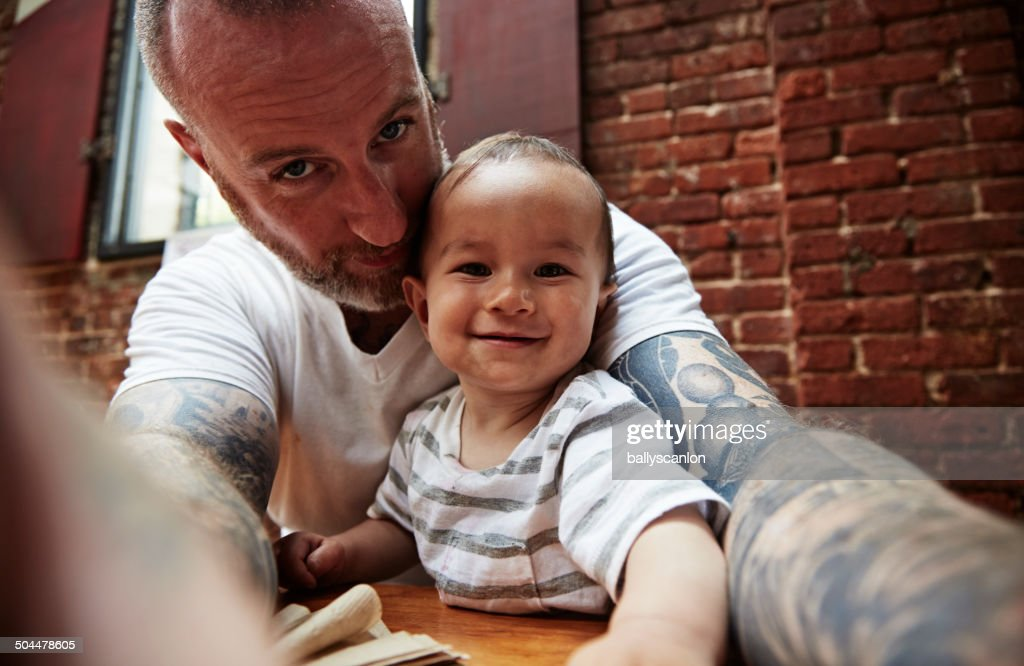 Father And Son Taking PIcture Together. : Stock Photo