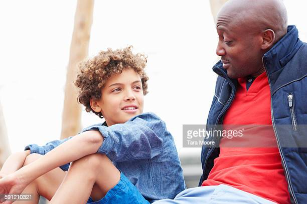 father and son talking - parenting stock pictures, royalty-free photos & images