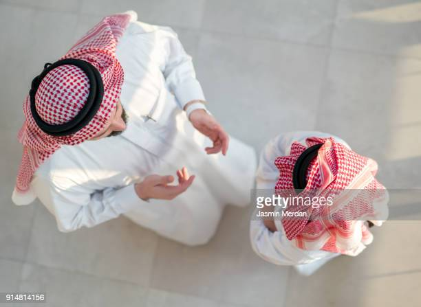 father and son talking - saudi stock pictures, royalty-free photos & images
