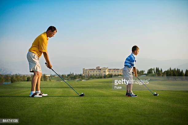Father and Son Teeing Off