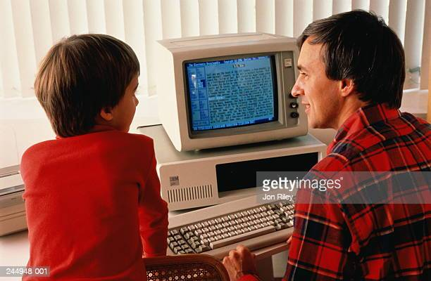 Father and son using home computer